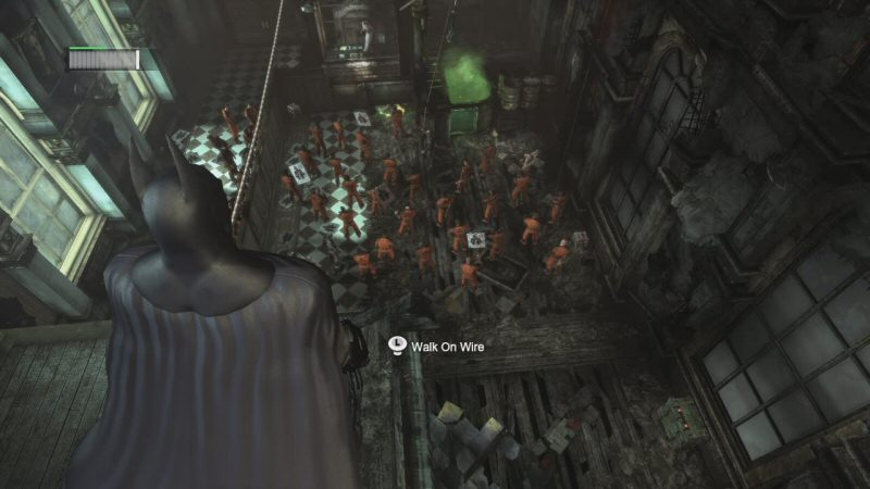 Top: Two Face is inside a shielded enclosure for the judge, like you find in courtrooms. To the right you can see Catwoman hanging over the typical vat of green acid. Batman is standing near the municipal tightrope.