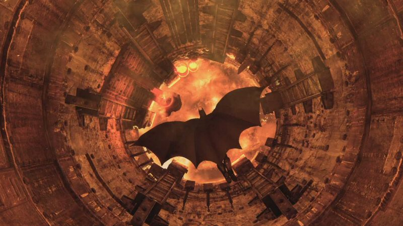 Batman enters the steel mill through the chimney. It results in this shot, which I believe is contractually obligated to happen at least once in every story.