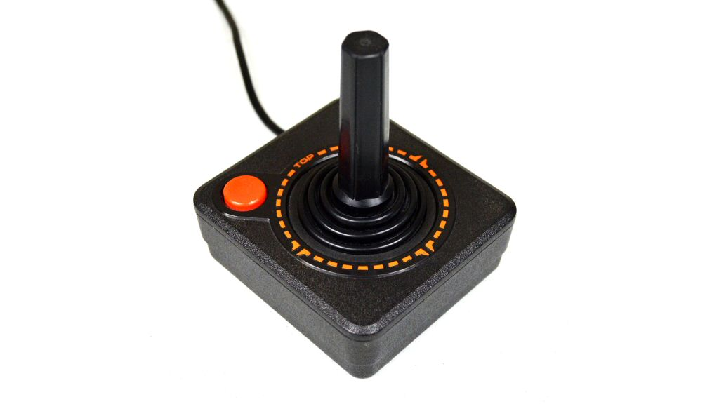 The ridges at the base of the stick were perfect for trapping a mixture of dust and sweat in the grooves where you could always see it, but never properly clean it. The single-button interface smothered game design. The case was made of rigid plastic and was designed to fit the hands of an adult male, even though the machine was marketed to kids. Gaming was off to a rough start.