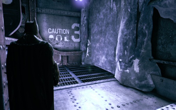 Hey look, it's a sheer wall of naturally occurring vertical ice, because that's how ice works, right? (In Arkham City there were also ice walls, but that game also had Mr. Freeze to explain them.) This thing isn't even near flowing water. It's just a random unexplained hunk of ice because the game designer decided it was time to have the player blow something up.
