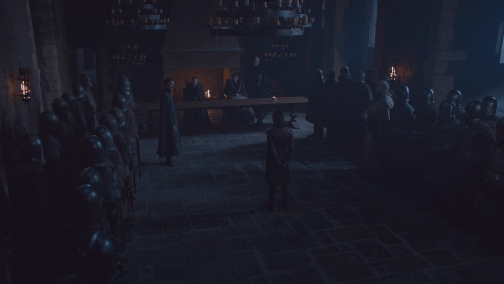 The people on the side are wearing helmets, so I guess they're soldiers and not northern lords. Are they doing this on purpose now? The northern lords seem to appear and disappear from Winterfell at random.