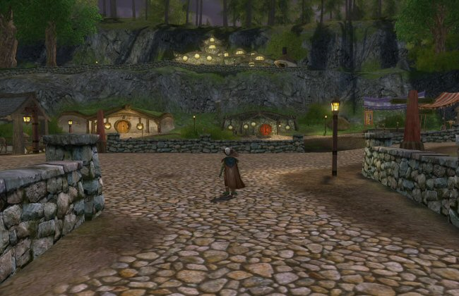 My one nitpick about the town designs is that the roads are generally far too broad. Heck, this would be too broad for Big People, and it`s crazy overkill for Hobbits. It doesn`t help that this cobblestone road texture doesn`t look great when used over large areas like this. Making the road narrower, with a shoulder of dirt on either side, would help a lot.