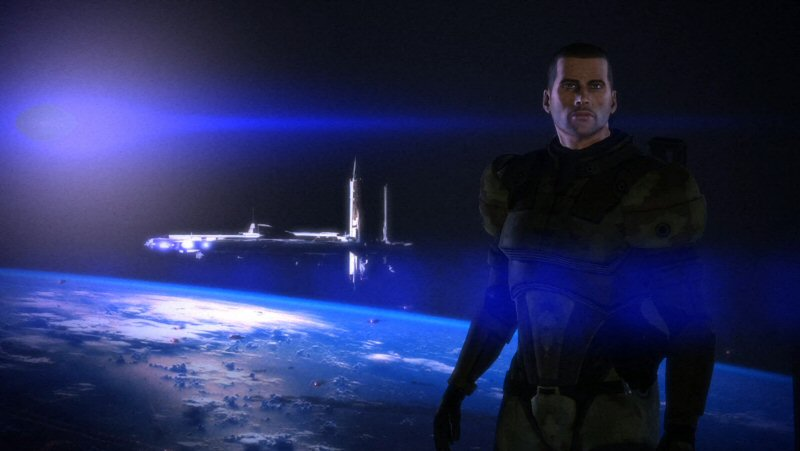 Just before the credits, Mass Effect 1 shows Shepard in front a planetary backdrop. There are explosions in the atmosphere, a lens-flare blue sun, and an unidentified space station / ship in the background. It`s not Earth. I wonder where this is supposed to be and what it was supposed to mean.