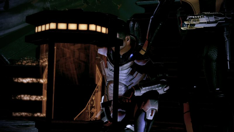 Aside: The cinematography in this scene is just awful. It's under-lit and there's no sense of geography. Characters often have their heads cropped out of the shot. Here it looks like Jacob has his back to the camera. If my Shepard was wearing the default black armor, then this screenshot would just be his head floating in a big black void. And of course the cinematographer never sets up  any contrast for all this ORANGE we've been staring at for the last hour. It's just another thing to subconsciously confuse or annoy the player at what should be the climax of the story.
