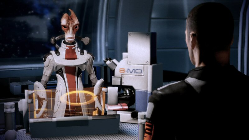 Does Mordin have a dialog wheel on that screen in front of him? I wish I had the option to ask him about it.