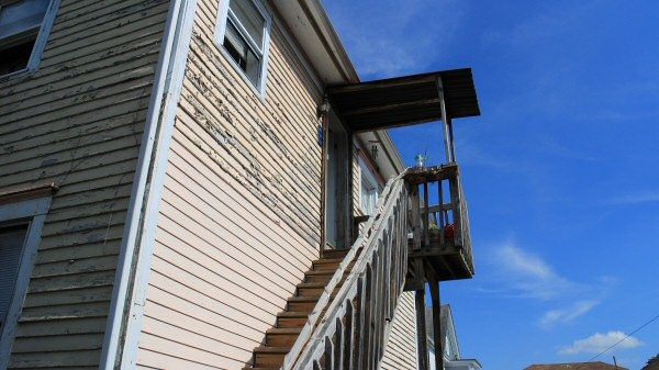 """Nothing says """"welcome home"""" like a staircase bolted to the side of the house."""