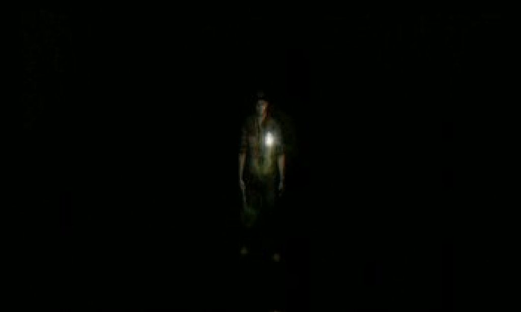 When Travis goes through a door the camera is aimed at him and his flashlight is aimed at stuff that's out of view.  You have to move him around a bit before you can work the camera into place so you can actually look at where you are.  Bonus points for the rooms where a monster ganks you as soon as you enter, before you can even see what you're doing.