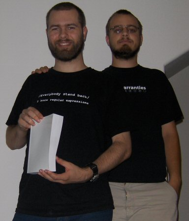 Clint (left) and Peter. (Right)  Clint is holding the first printed draft.