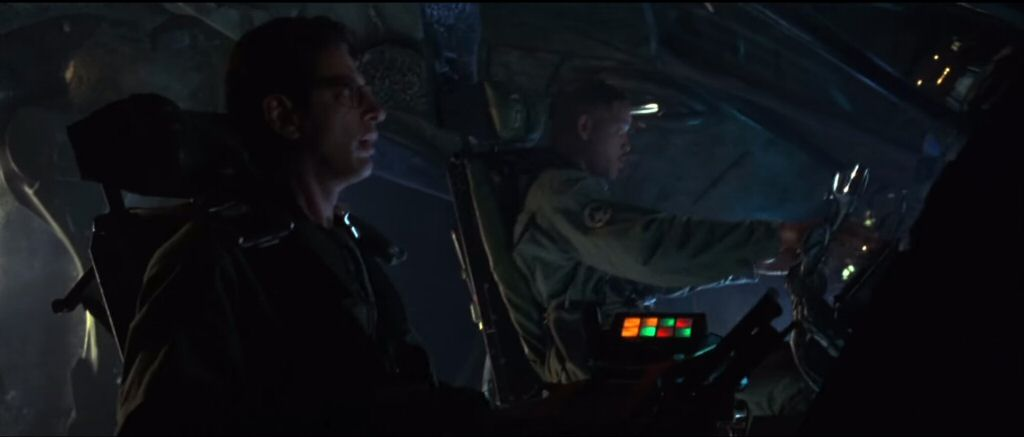 In Independance Day (1996) the good guys upload a virus to an alien computer. It`s the most implausible moment in a movie that already has a hilariously young Bill Pullman playing the president.