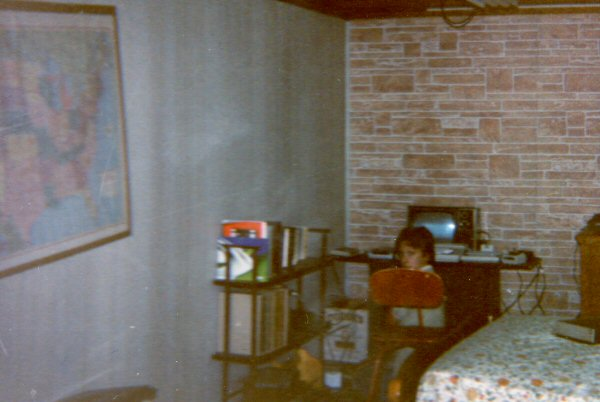 This is an awful photo, but there are a lot of artifacts in it. On the far left you can see the map from Neighbor John.  On the bookshelf you can see Art and the Computer. Here I'm working at my computer, which is hooked up to a television, as was the custom in those primitive days.