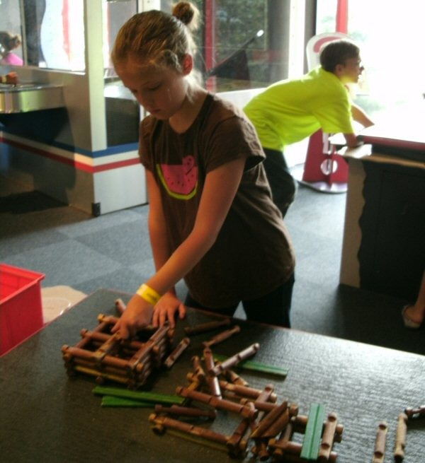 """Dear Science Center: LINCOLN LOGS ARE NOT SCIENCE. They are the opposite of science. They are a low-tech toy that mimmics a very low-tech building technique. Having Lincoln Logs at the science center is like having a horse at an auto show. The only way this qualifies as science is in the archaeological or historical sense. </p> <p>But I gotta hand it to Lincoln Logs as a product. The toy is a hundred years old, and in all that time they haven't changed a bit: No glow-in-the-dark, no fancy colors, no gimmicky playsets, no crossovers, no cutting corners with plastic logs, no chasing trends. Wood logs, green roof slats, and that's it. <a href=""""https://www.google.com/search?q=lincoln+logs&rlz=1C1CHFX_enUS518US518&oq=lincoln+logs"""">Even the packaging</a> has been immutable for over half a century."""