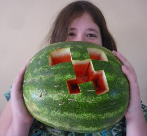 Rachel with a Minecraft Creeper style watermelon. WHAT NOW, GALLAGHER?