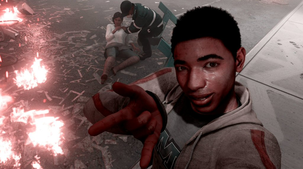 Amusingly, the game still allows you to use photo mode in this harrowing scene. Here Miles is posing for a quick selfie with his unconscious mother during a terrorist attack.