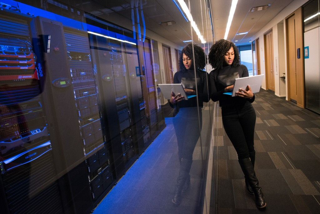 I couldn't find a stock photo of an abstract concept of a database, so here's a random woman leaning against the windows of the server room in a way that looks cool but is probably against some stupid rule.