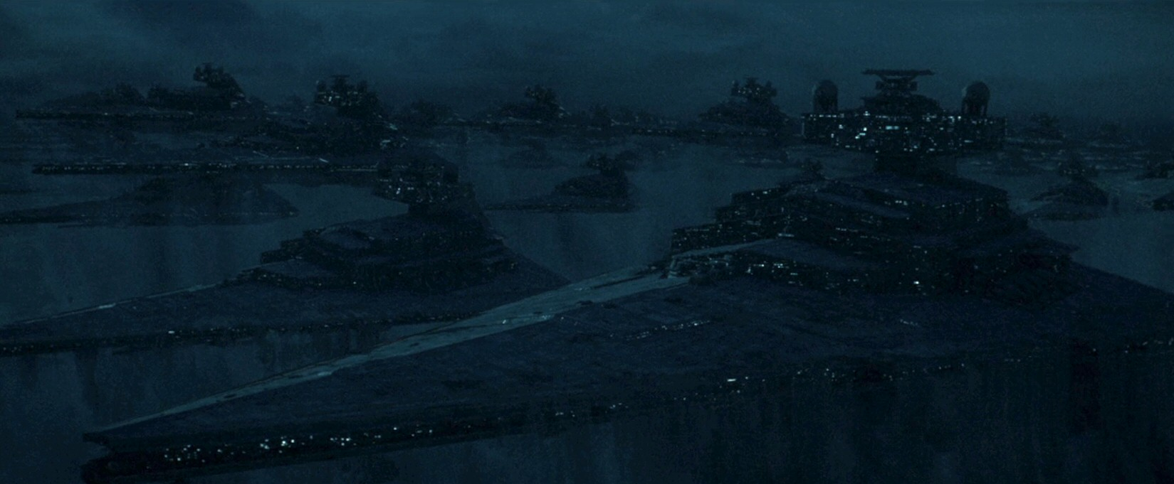 The visuals were so dark I couldn't tell if the SURPRISE FLEET was buried in dirt or ice. Either way, this is a very unconventional way of storing a fleet. (Not to mention the hundreds of thousands of otherwise normal people to operate it.)